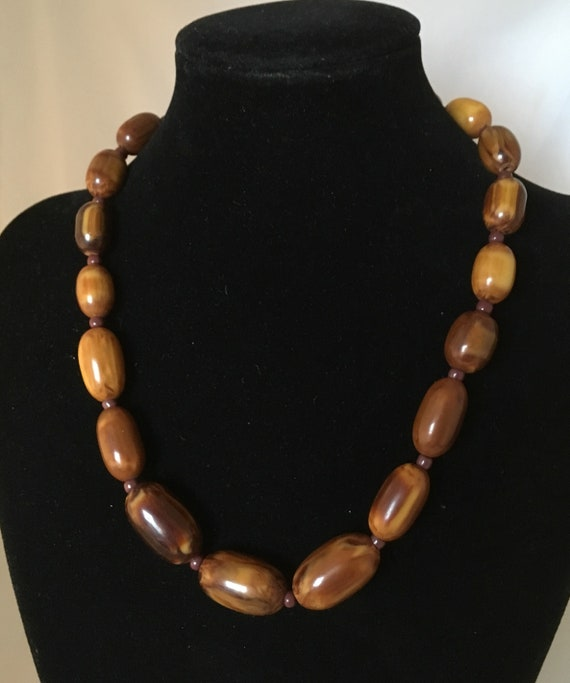 Brown Bakelite marble necklace, with small glass b