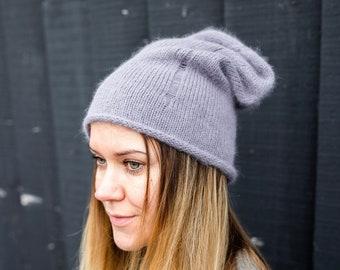 72531c43f84 Angora gray ripped beanie hat