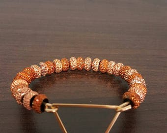 Gold beaded triangle bracelet