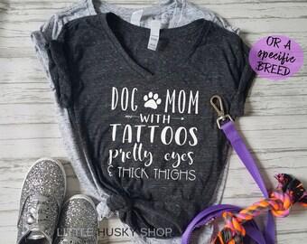 b81620f8dd216 Dog Mom with Tattoos Pretty Eyes and Thick Thighs - Funny Dog Mom Shirt - Tattooed  Dog Mom - Tattoos and Dogs Thick Thighs Soft T Shirt Gift