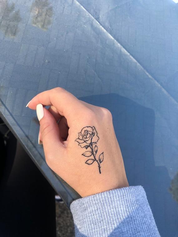 Hand tattoos kleine Tattoo am