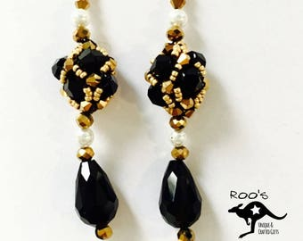Black long earrings with clearwater pearls