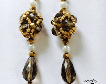 Grey and golden earrings with clear-water pearls