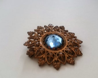 antique brass blue cabochon brooch