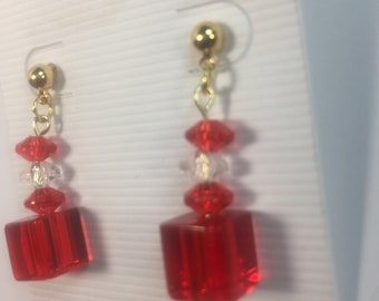 Red cube and gold colored earrings