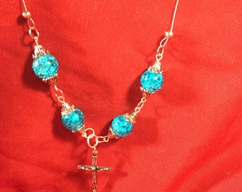 Blue bead and cross necklace