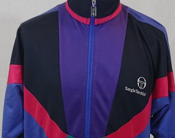 1629a1eda44 Sergio Tacchini vintage jacket. Really oldschool item from gotbeefshop in  size L. Multicolor and old school.