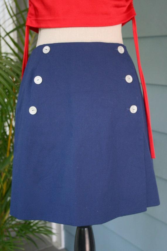 Blue cotton vintage button-front 60s mini-skirt.