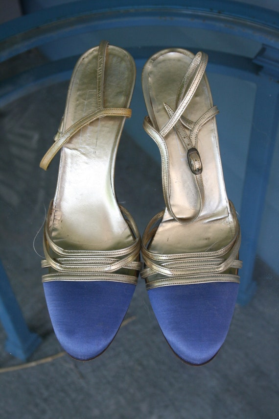 Blue and gold strappy sandals.