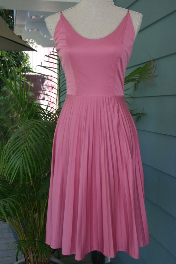 Lipstick pink 70s dress with pleated skirt.