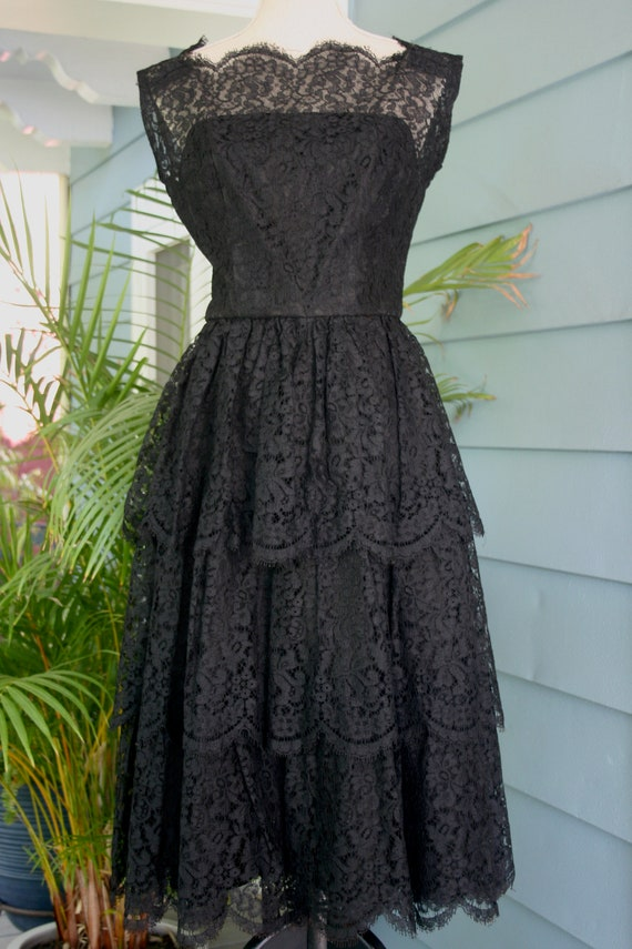 Black tiered lace 50's evening gown.