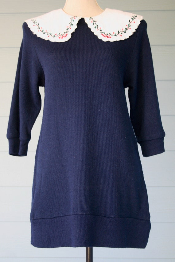 Navy blue 80s sweater dress with exaggerated embro