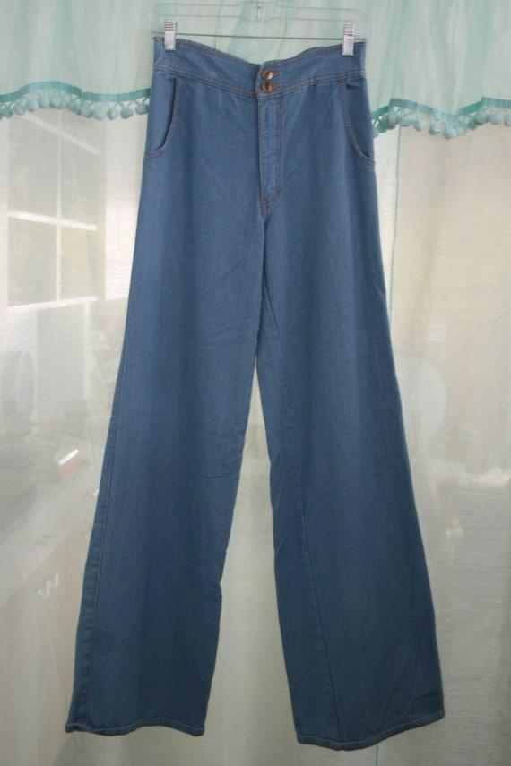 Blue 70s style wide-leg jeans.
