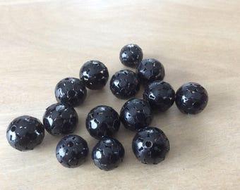 Black filigree metal bead