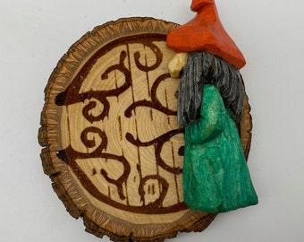 Gnome in front of door fridge magnet