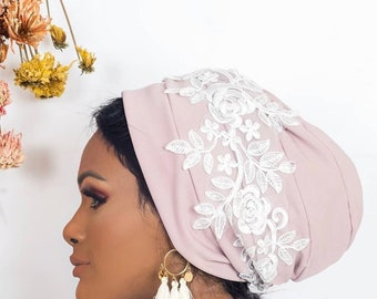 Floral embroidered Lycra turban.