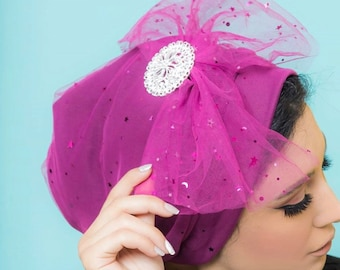 Stars and dots pattered tulle turban with removable silver accessories.
