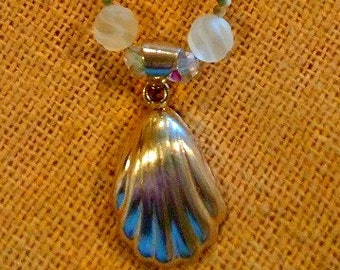 Sterling Silver Shell Pendant strung with Carved Frosted Rock Crystal