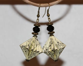 Music paper bead earrings.