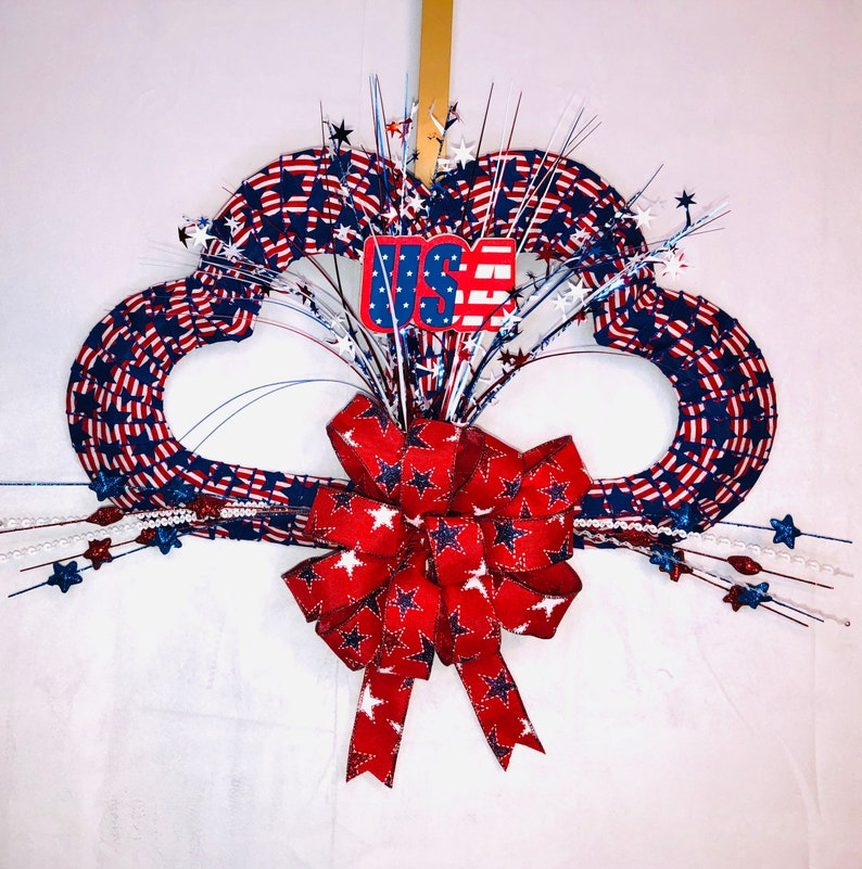 Spread twice the patriotic cheer with this fabulous double heart wreath you can purchase at Etsy. Or try to make your own. Here are some darling ideas for 4th of July DIY door wreaths. You will love them!