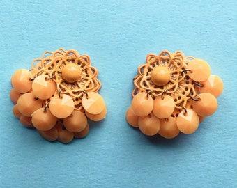 Funky orange 60s clip on earrings in a crochet design