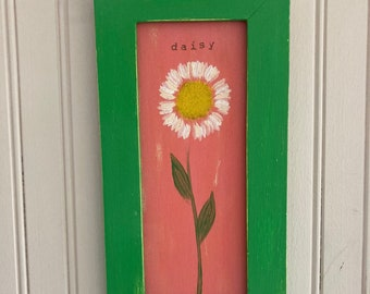 Daisy hand painted on wood in a green painted 6 1/4 inches W by 12 inches L wood frame