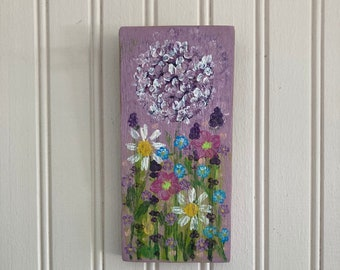 Hydrangea garden hand painted on a 3 1/4W by 7L piece of light purple painted barn wood