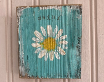 Daisy hand painted on a 3 1/2 W by 4  L piece of barn wood