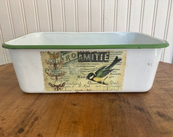 Vintage white and green enamelware with bird label on one side.  Measures 12 inches length, 7 1/2 inches wide and 4 inches tall