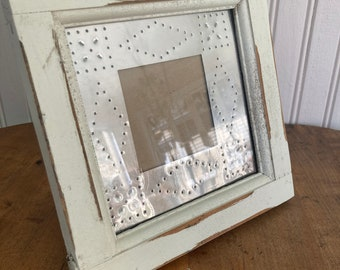 Distressed off white 8 1/4 inch wood frame with glass, punched metal insert,  and 3 inch square for photo