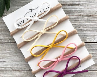 8d80d5b75 Dainty faux suede cord bows, set of 5, nylon headbands, newborn, baby,  girl, hair bows, white, ivory, mustard, pink, purple