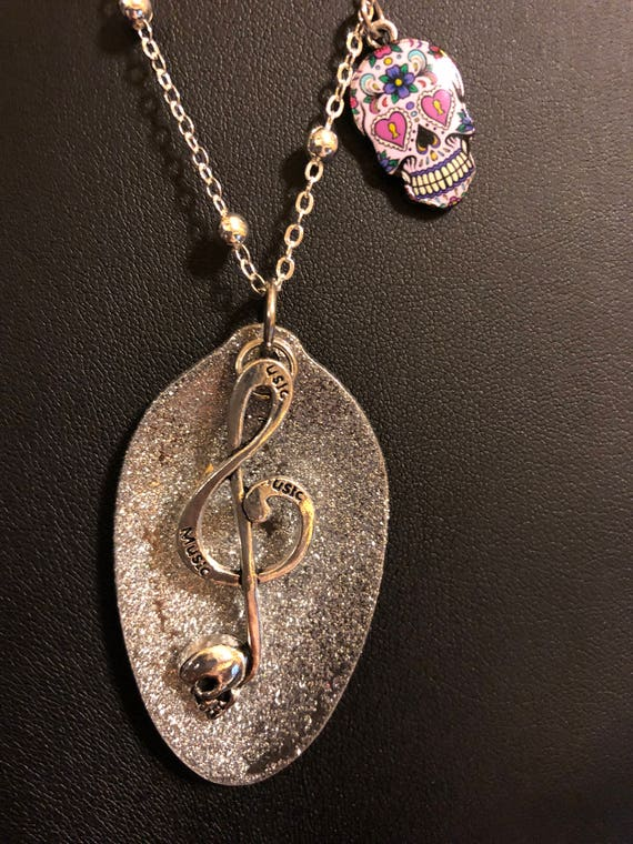 Beautiful painted spoon necklace with music note dangle on a beaded silver plate chain with a sugar skull dangle