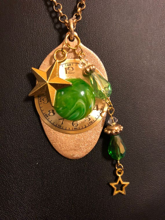 Recycled golden painted spoon necklace with watch face, green resin and glass stones with star and stone dangle
