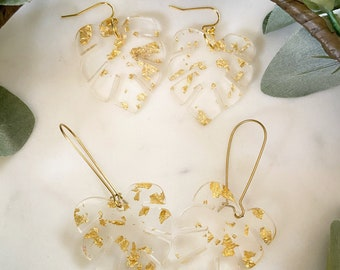 Clear and gold speckled palm leaf acrylic earrings