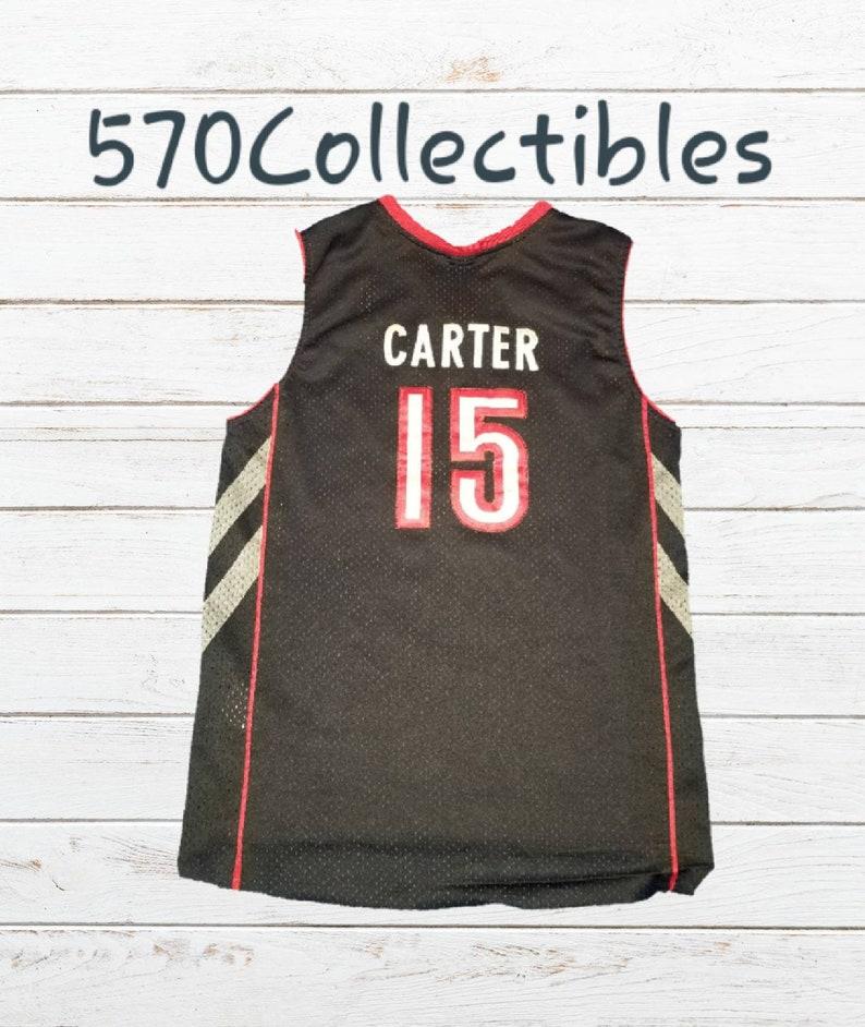 07ea409b4ecf Vintage Nike Toronto Raptors Vince Carter Basketball Jersey
