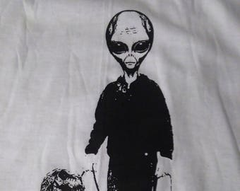 Alien walking trex screenprinted tshirt.