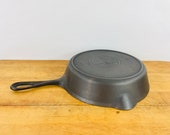 Griswold Slant Logo 6, 699 E. quot ERIE quot cast iron skillet w Heat ring. Erie PA in 1906-1912. Excellent used condition. Rare, hard to find.