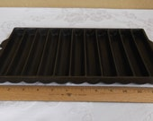 Unmarked 11-slot bread stick pan. ERIE PA USA. Excellent Condition. Pre- 1960 manufacture.