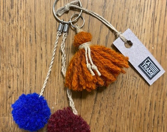 Key ring trio of plain pompoms, handcrafted handcrafted in wool and linen