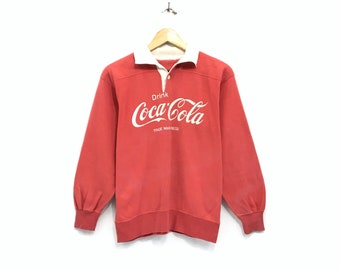 474fe68d7d Coca Cola Rugby Half Button Sweatshirt Jumper Big Logo Spell Out Pullover /  Fashion Style / Streetwear / Small Size / Red Colour