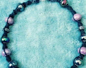 Black hemp necklace with  multi-colored luminescent beads