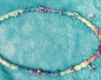 Rainbow colored hemp necklace with metal beads and butterfly pendant
