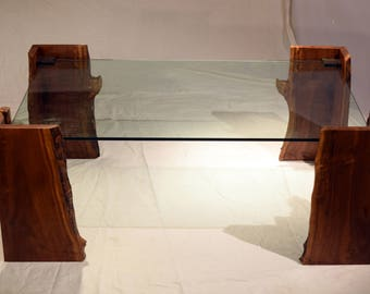 Black walnut contemporary glass coffee table with live edges and steel fittings for floating glass appearance