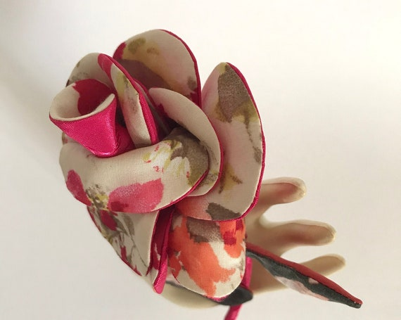 Textile brooch inspired by pink fashion accessory