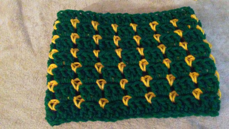 Adult size green and gold ear warmer.