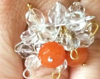 ring with orange charms