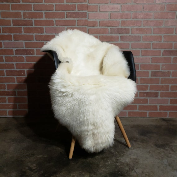 "50"" X 30""  Large, soft,  plush & cozy Genuine Sheepskin fur throw rug"