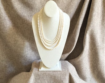 White freshwater pearls hand strung with sterling silver findings