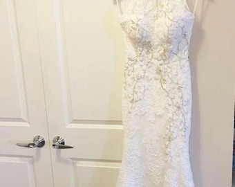 Wedding gown with emboided details