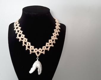 Silver tone double feather tatted necklace.
